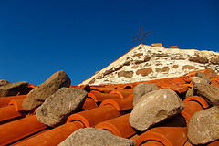 Example of rocks placed on roof. Photo taken by Nick Perez in 2010, posted on Flickr.